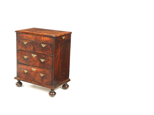 A rare small Queen Anne walnut crossbanded and featherbanded chest