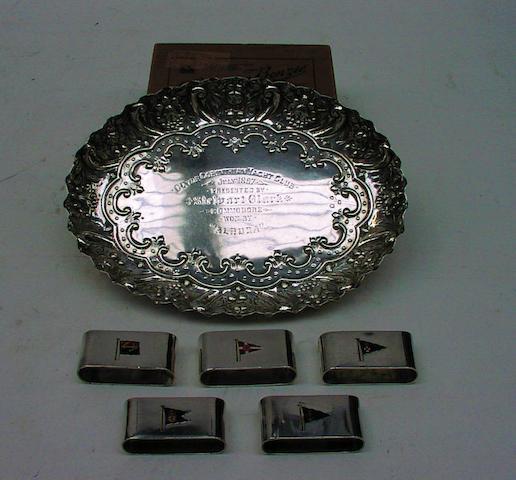 A set of five George V silver serviette rings, 6