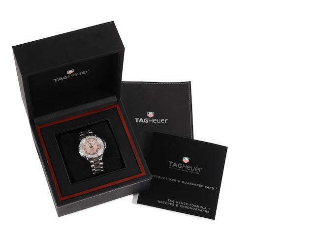 Tag Heuer: A lady's Formula 1 diamond set wristwatch