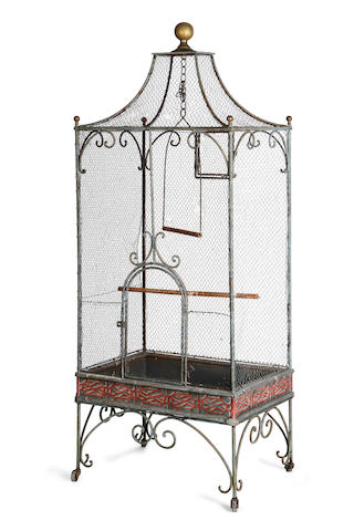A large early 20th century metal birdcage on a painted stand