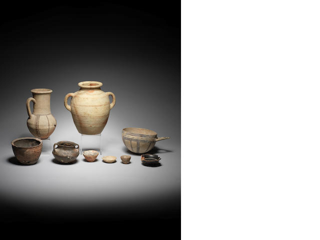 A group of Ancient pottery vessels and two vessels, a lot