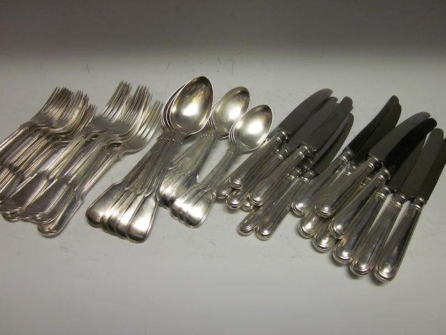 An Edwardian fiddle and thread  pattern canteen of flatware and cutlery, by H W Ld,  Sheffield 1905,