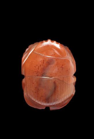 An Egyptian carnelian scarab