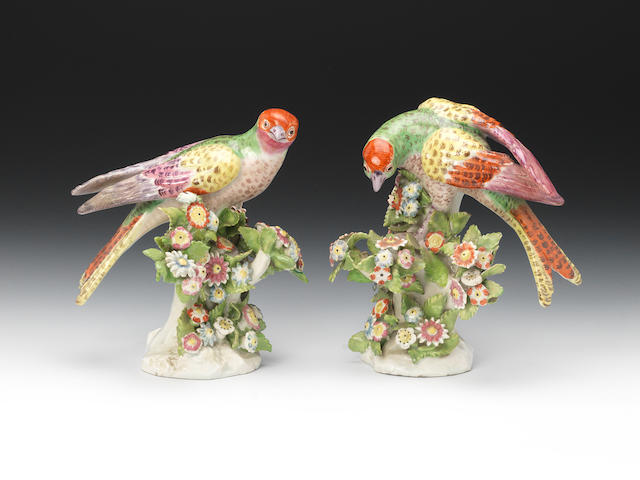 A pair of Bow models of parrots, circa 1770, Perched on flowering bocage, anchor and dagger marks (some restoration)