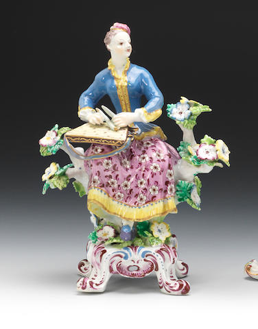 A Bow figure of a lady zither player