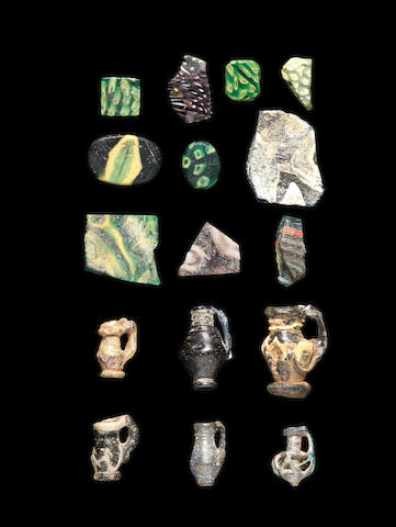 A group of forty-two Roman mosaic glass fragments  seven Byzantine miniature glass juglets, 49
