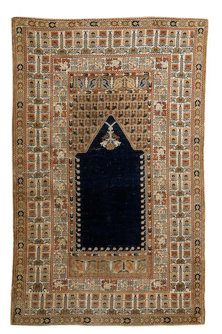 A Pandirma prayer rug, West Anatolia, circa 1910, 6 ft 1 in x 3 ft 10 in (185 x 117 cm) minor losses at each end and minor wear