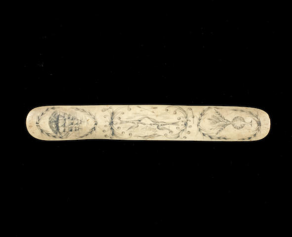 A 19th century decorated whalebone stay busk. 15ins. (38cm)long.