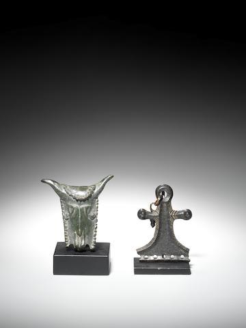 A Greek bronze bucranium attachment and a European bronze pendant fitting 2