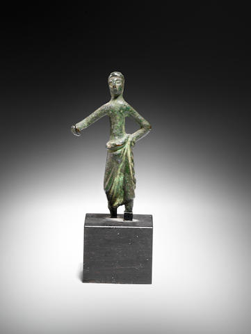 An Etruscan bronze votive figure of a man
