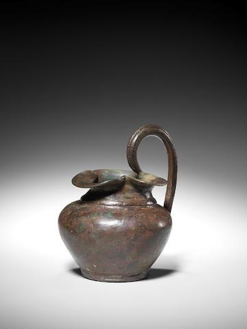 An small Etruscan bronze oinochoe
