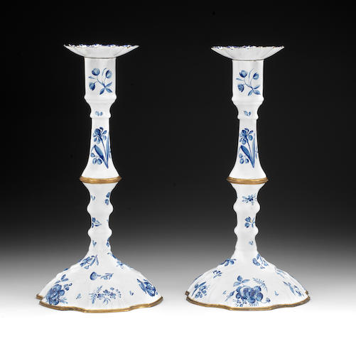 A Pair of Birmingham enamel candleticks and sconces