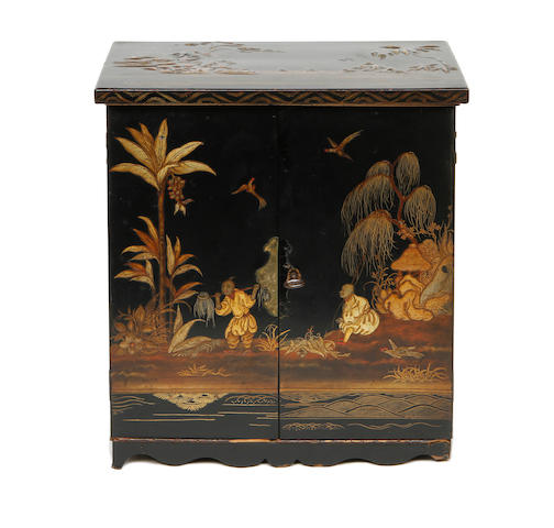 A Chinese black lacquered table cabinet,