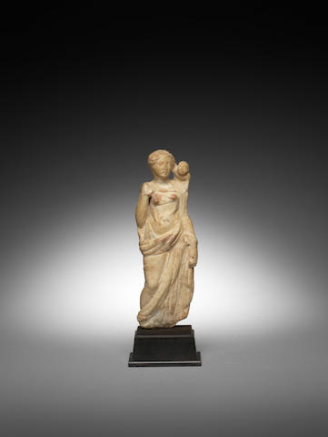A Roman marble figure of Aphrodite with Cupid