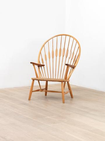 Hans Wegner for Johannes Hansen Peacock Chair designed 1947 and executed circa 1955  stamped Johannes Hansen Copenhagen Made in Denmark ash, teak and cord  Height: 108 cm.                42 1/2 in.
