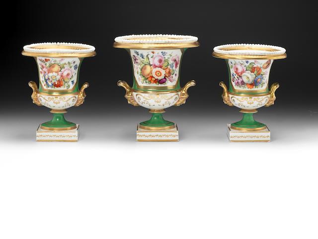 A Minorn garniture of three camapana vases