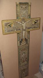 A metal thread and embroidered fabric crucifix