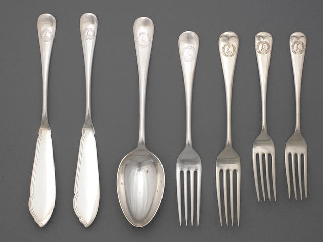 TERRA NOVA A collection of flatware from the Terra Nova, comprising four forks, two fish knives, and one spoon (7)