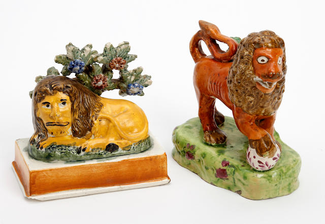 Two unusual Staffordshire figures of lions, early 19th century