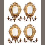 A set of four gilt brass triple light mirror backed sconcesLate 19th/early 20th Century Continental,