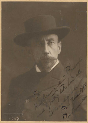 AMUNDSEN (ROALD) Portrait, head and shoulders in fine clothes, with hat, INSCRIBED AND DATED (Rome, January 1917) BY AMUNDSEN on the image