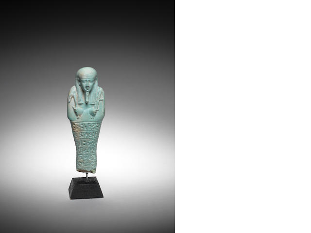An Egyptian turquoise glazed composition shabti