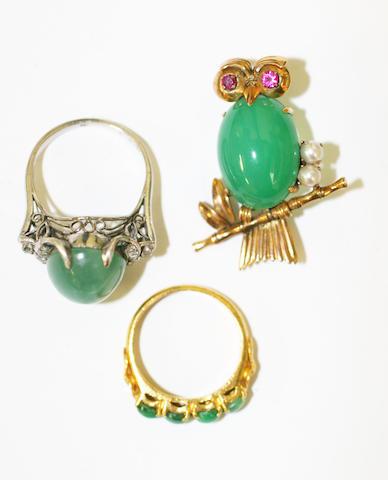 A jade half hoop stone ring, (3)