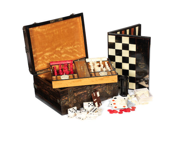 A coromandel and brass mounted games compendium in the Gothic style, by Leuchars, circa 1870, with a Jaques ivory chess set,