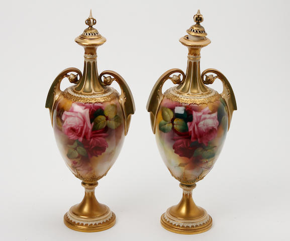 A matched pair of Royal Worcester pedestal vases  Dated 1898 and 1902