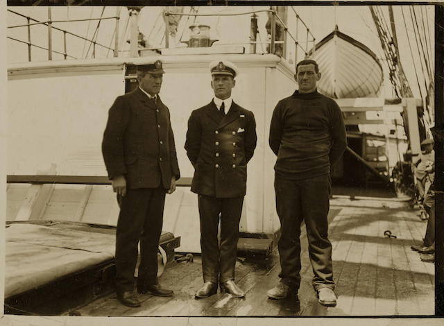 TERRA NOVA EXPEDITION Group portrait on deck of the Terra Nova of Evans with William Lashly and Tom Crean, who saved him on the return from the Beardmore Glacier, after parting from the Polar Party, [1912]