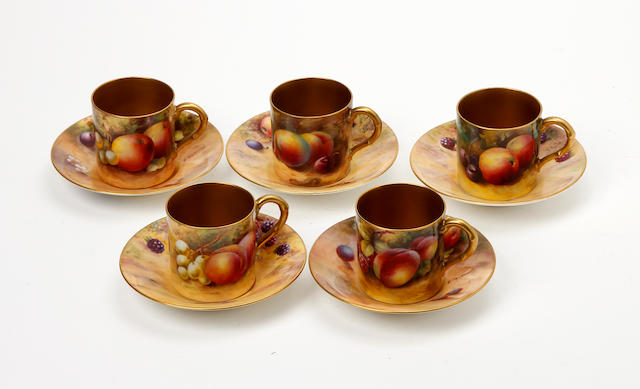 A collection of Royal Worcester fruit painted matched coffee cans and saucers, painted by various artists All dated 1930