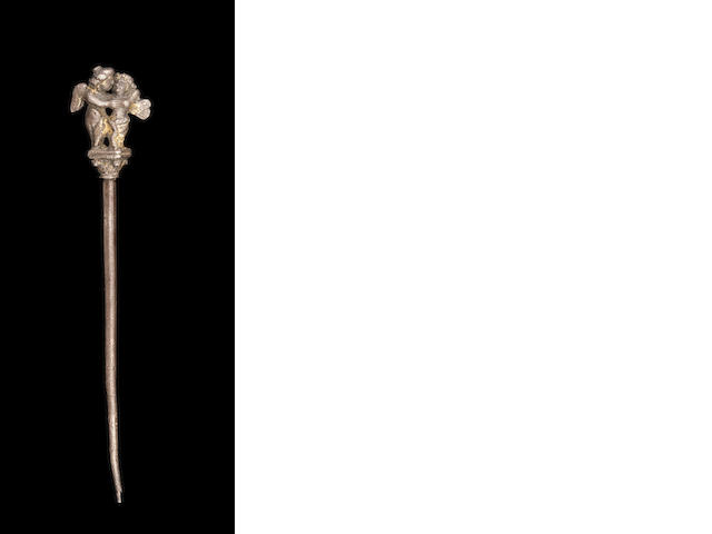 A Roman gilt silver pin of Eros and Psyche