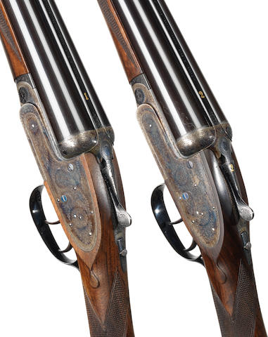 A fine pair of 12-bore self-opening sidelock ejector guns by J. Purdey & Sons, no. 28301/2 In their leather motor-case with canvas cover
