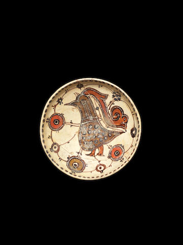 A small Sari ware bowl with bird 11th century