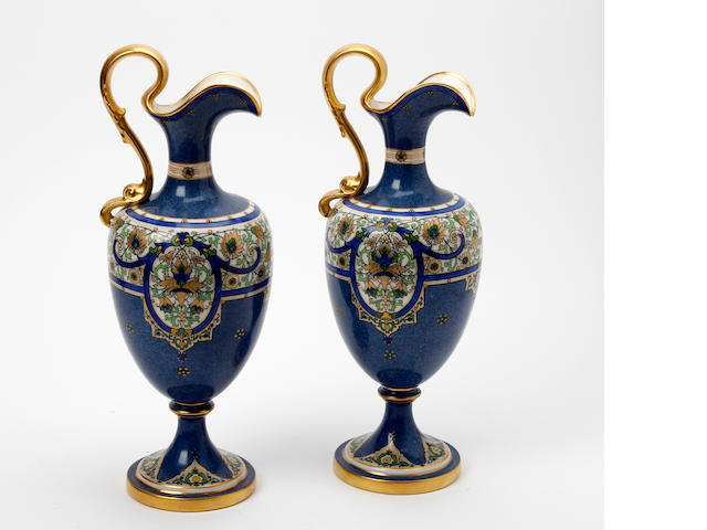 A pair of Royal Worcester powder blue ground ewers  Dated 1920