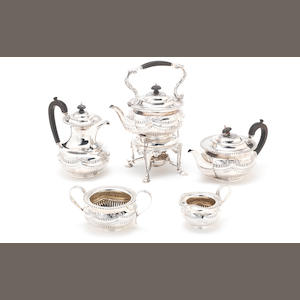 An Edwardian silver five-piece tea and coffee service including kettle on stand, by James Deakin & Son, Sheffield 1905 / 1906,  (5)