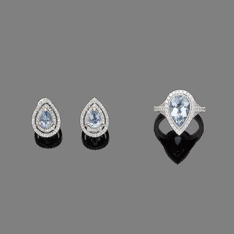 An aquamarine and diamond cluster ring and pair of earrings (2)