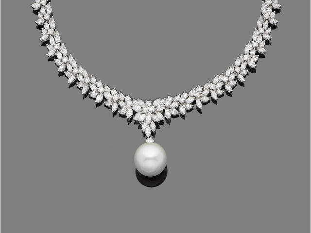 A diamond and cultured pearl pendant necklace