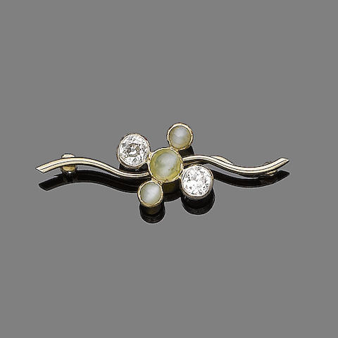 A cat's-eye and diamond brooch,
