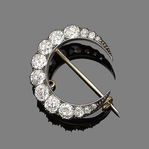 A diamond crescent brooch,