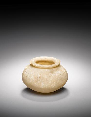 A Mesopotamian alabaster vessel