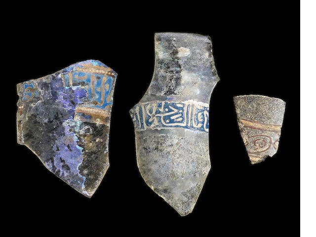 Three Islamic glass fragments with inscription