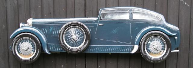 A hand-painted wooden profile of Wolf Barnato's 'Blue Train' Bentley,