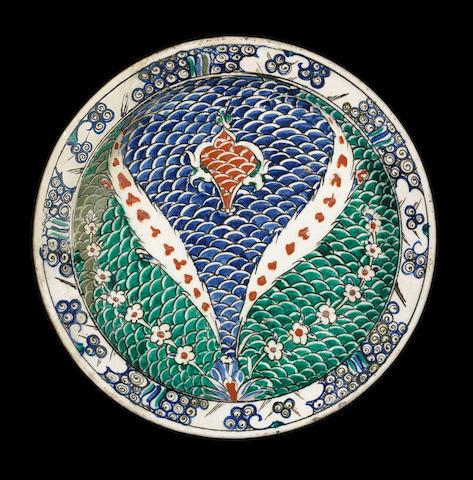 An Iznik fishscale motif polychrome pottery Dish Turkey, circa 1580