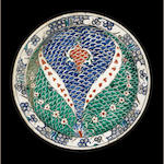 An Iznik fishscale motif polychrome pottery Dish Turkey, circa 1580