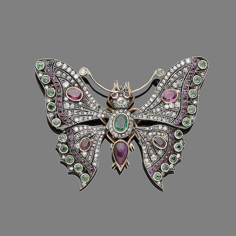 A diamond, ruby, emerald and garnet butterfly brooch