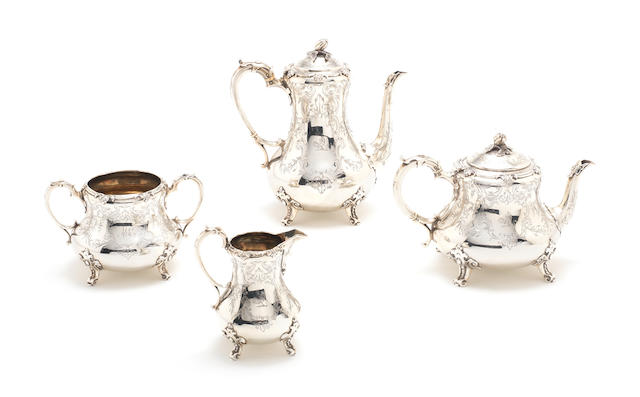 A Victorian silver four-piece tea and coffee service, with the mark of Robert Harper overstriking another, London 1858,  (4)