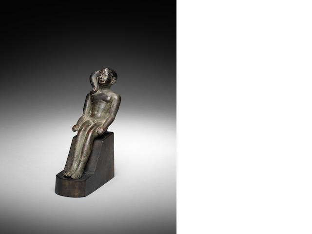 An Egyptian bronze seated Harpokrates figure