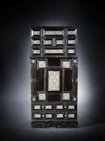 A dark wood cabinet with Gujarat inlaid doors