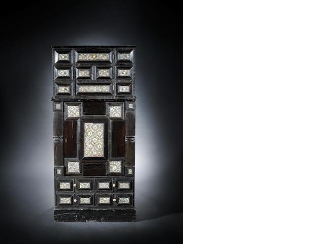 A dark wood cabinet with Gujarat inlaid doors